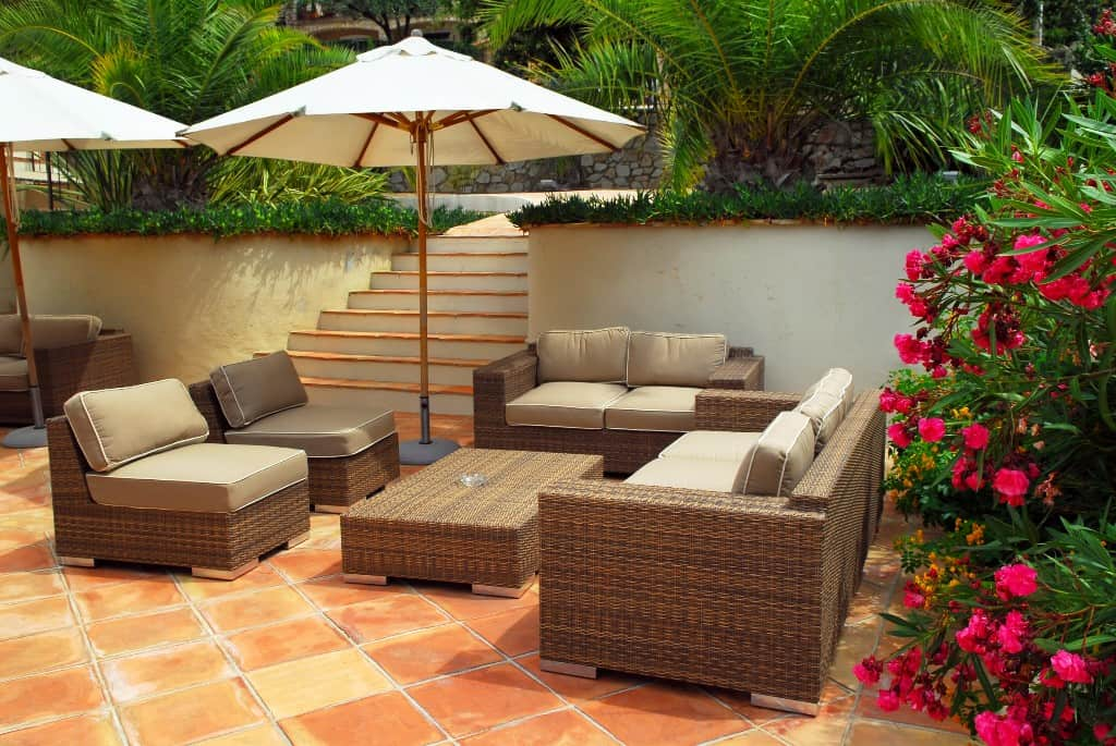Wicker furniture a classy outdoor furniture choice for Garden patio sets